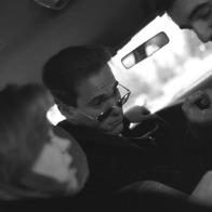 people talking in a car
