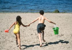 kids running towards the water