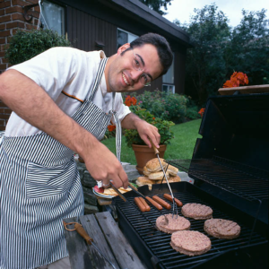 man cooking on a grill